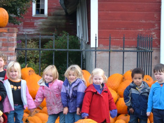 Sophie in Fall of 2005 with her preschool going to the pumpkin patch. I took the day off of work to go with her. She's so small.